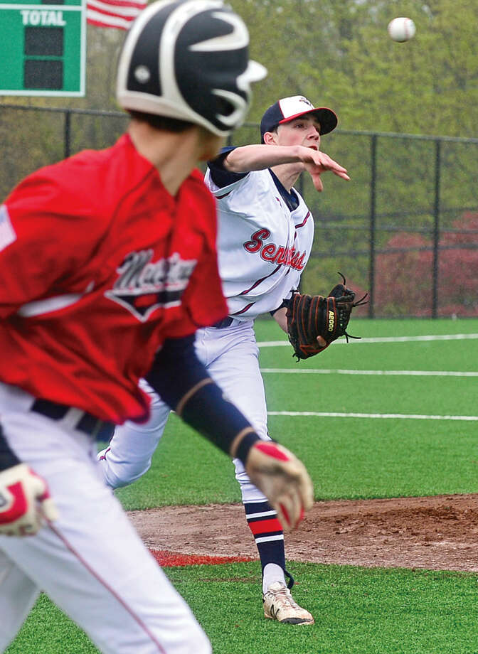 Brien McMahon High School pitcher Jeff Vitatoe throws out a Fairfield Warde baserunner during their FCIAC baseball game Saturday May 7, 2016, in Norwalk, Conn.