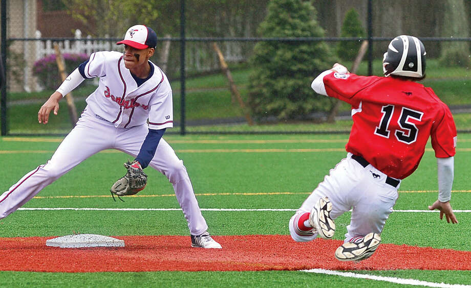 Brien McMahon High School second baseman Wady Almonte waits for the throw as Fairfield Warde baserunner #15 Joey Deutsch comes into second during their FCIAC baseball game Saturday May 7, 2016, in Norwalk, Conn.