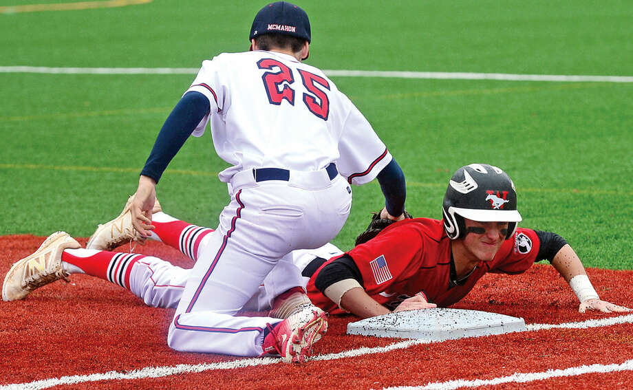 Brien McMahon High School first baseman Matthew Galyas tries to get the tag on Fairfield Warde baserunner John Natoli during their FCIAC baseball game Saturday May 7, 2016, in Norwalk, Conn.