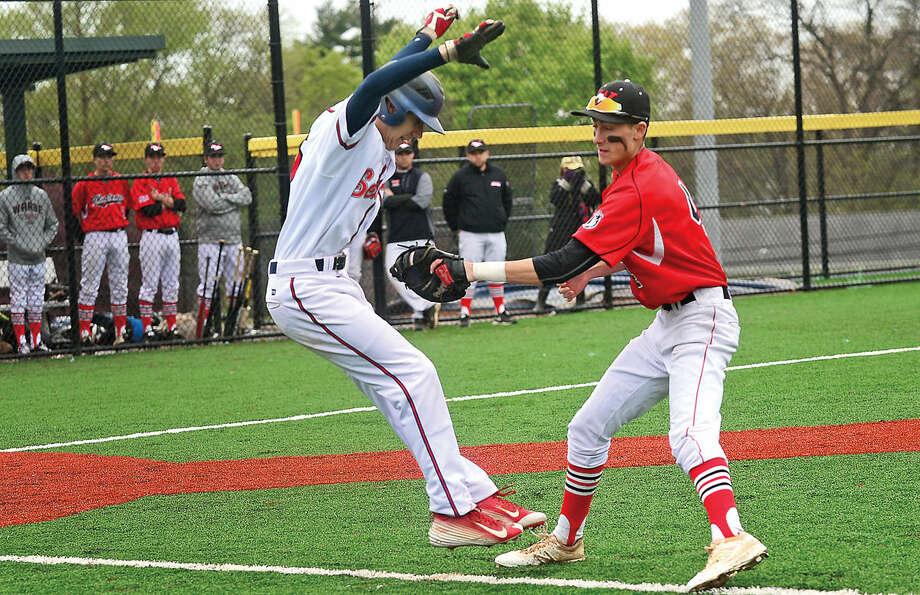Fairfield Warde High School first baseman #4 John Natoli tags out Brien McMahon's Matt Galyas in a sacrafice bunt attempt during their FCIAC baseball game Saturday May 7, 2016, in Norwalk, Conn.