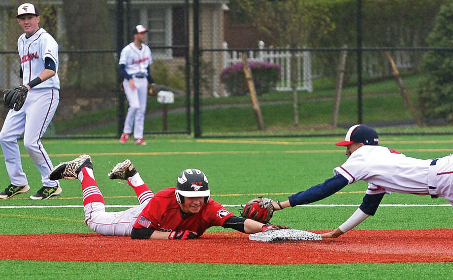 Fairfield Warde High School baseball player #17 Reece Maniscalco gets back to second before Brien McMahon second baseman Wady Almonte gets the tag in their FCIAC baseball game Saturday May 7, 2016, in Norwalk, Conn.