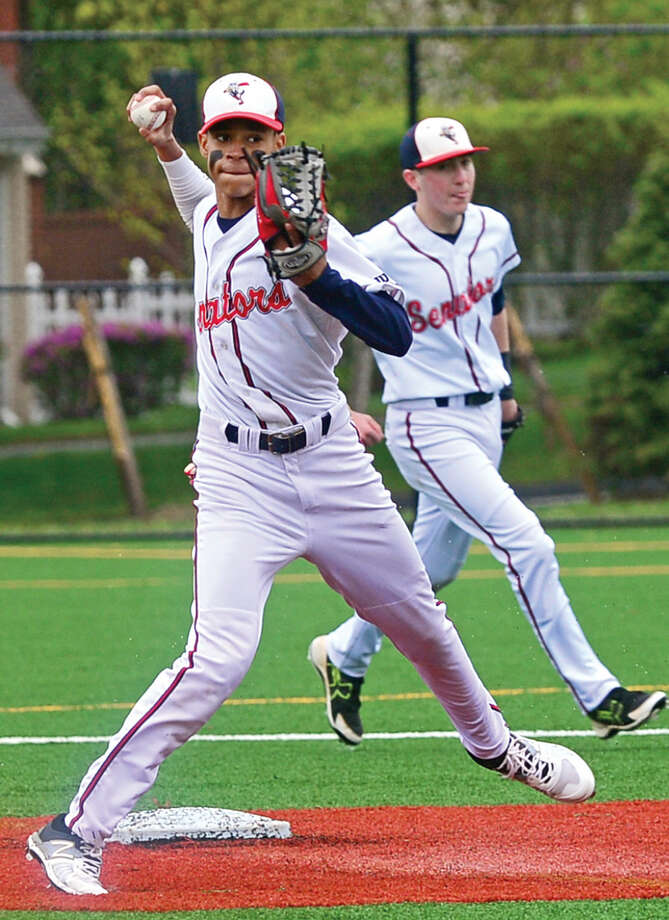 Brien McMahon High School second baseman Wady Almonte throws to first during their FCIAC baseball game against Fairfield Warde Saturday May 7, 2016, in Norwalk, Conn.