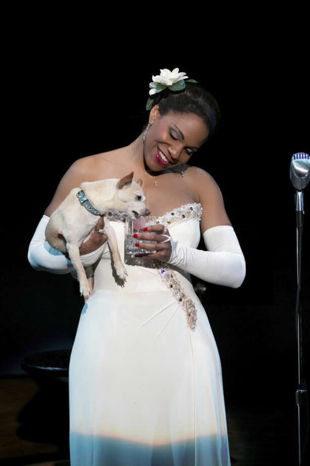 "This photo provided by Jeffrey Richards Associates shows Audra McDonald as Billie Holiday in ""Lady Day at Emerson's Bar & Grill"" while holding Roxie. This Broadway season has been rich with roles for African-Americans and audiences are responding, from the packed Brooks Atkinson Theatre, where the musical ""After Midnight"" celebrates Duke Ellington's years at the Cotton Club, to the standing-room only Circle in the Square, where Audra McDonald is channeling Billie Holiday. (AP Photo/Jeffrey Richards Associates, Evgenia Eliseeva)"