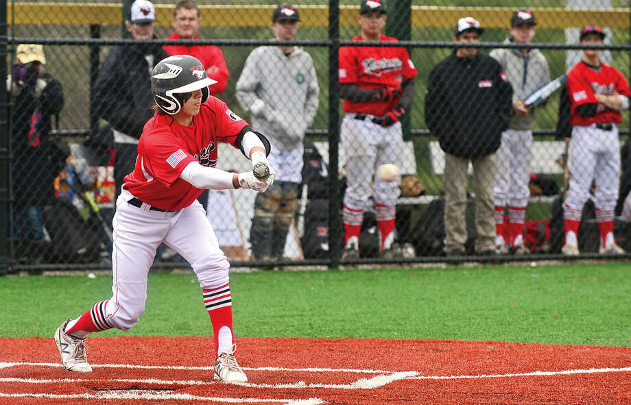 Fairfield Warde High School third baseman #15 Joey Deutsch lays down a bunt during their FCIAC baseball game against Brien McMahon Saturday May 7, 2016, in Norwalk, Conn.