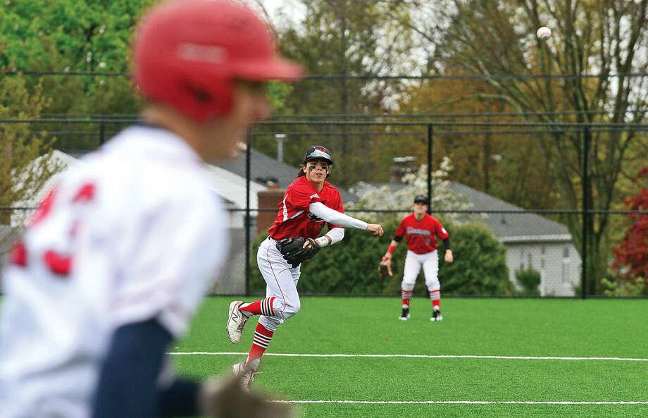 Fairfield Warde High School third baseman #15 Joey Deutsch throws out a Brien McMahon baserunner in FCIAC baseball Saturday May 7, 2016, in Norwalk, Conn.