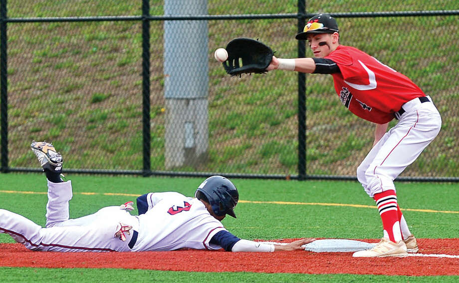 Fairfield Warde High School first baseman #4 John Natoli looks to tag out a Brien McMahon baserunner Wady Almonte during their FCIAC baseball game Saturday May 7, 2016, in Norwalk, Conn.