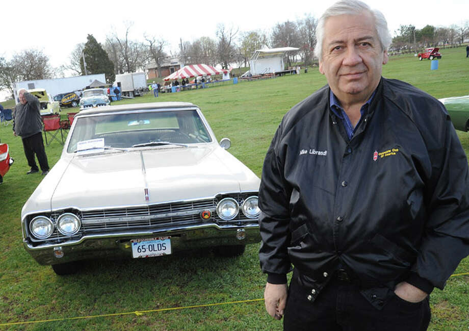 Mike Librandi with his 1965 Oldsmobile Cutlass Convertable Sunday at the Auto Show & Flea Market held at Norwalk's Taylor Farm. Hour photo/Matthew Vinci