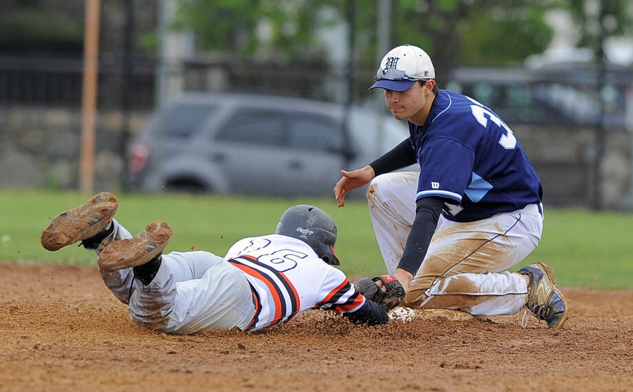 Wilton Dillon Lifrieri places the tag on Stamford Jorge Lopez to end the fifth inning of a baseball game in Stamford on Saturday, May 7, 2016. Stamford defeated Wilton 3-2.