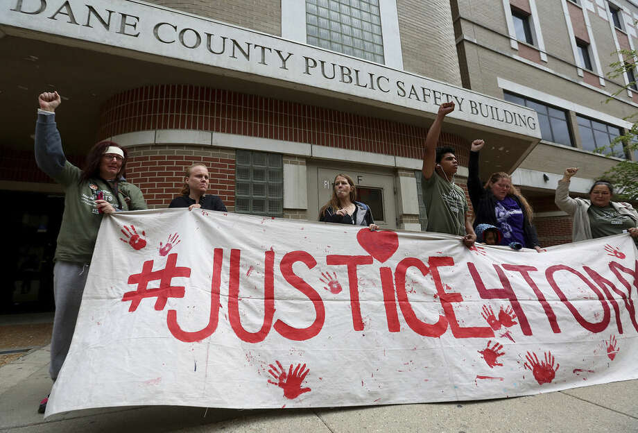 Supporters of Tony Robinson gather outside the Dane County Public Safety Building in Madison, Wis. Tuesday, May 12, 2015 after Dane County District Attorney Ismael Ozanne cleared Madison officer Matt Kenny of any wrongdoing in a shooting of the unarmed 19-year-old in March 2015. (AP Photo/Wisconsin State Journal, John Hart)