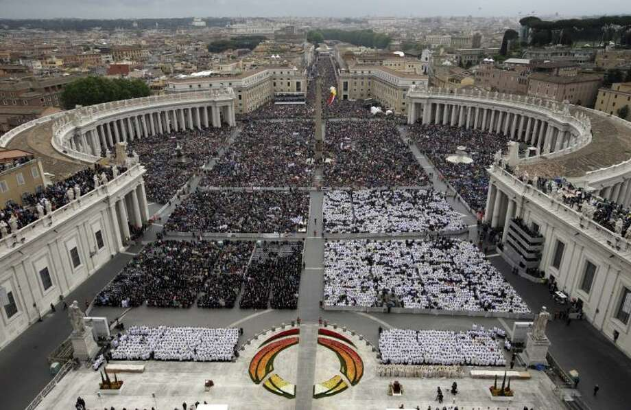 Faithful fill St. Peter's Square at the Vatican, Sunday, April 27, 2014. Pope Francis has declared his two predecessors John XXIII and John Paul II saints in an unprecedented canonization ceremony made even more historic by the presence of retired Pope Benedict XVI. (AP Photo/Andrew Medichini)