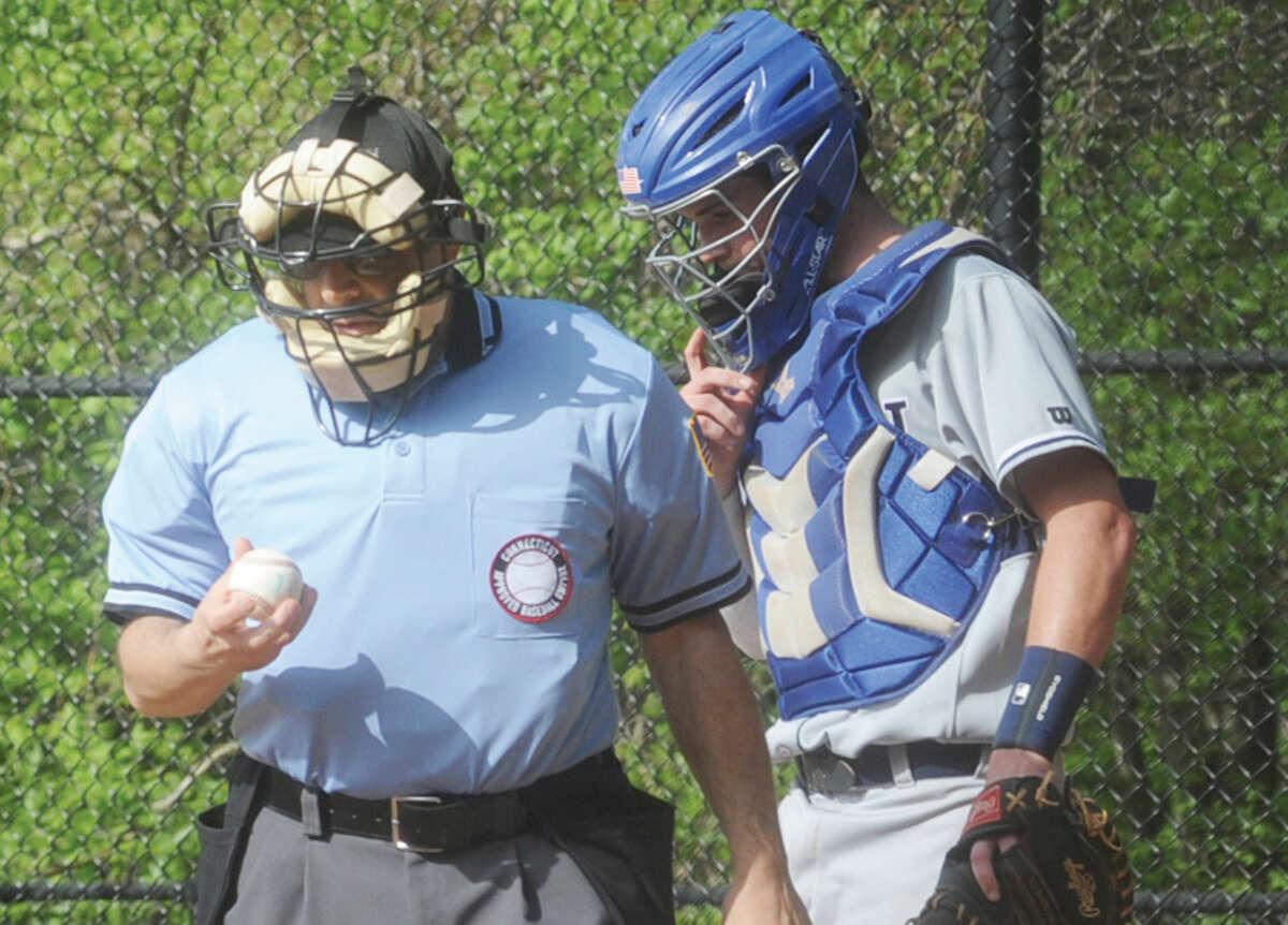 Home plate umpire Vinny Procaccini with Wilton baseball catcher Alex Jacobson. (Hour photo/Matthew Vinci)