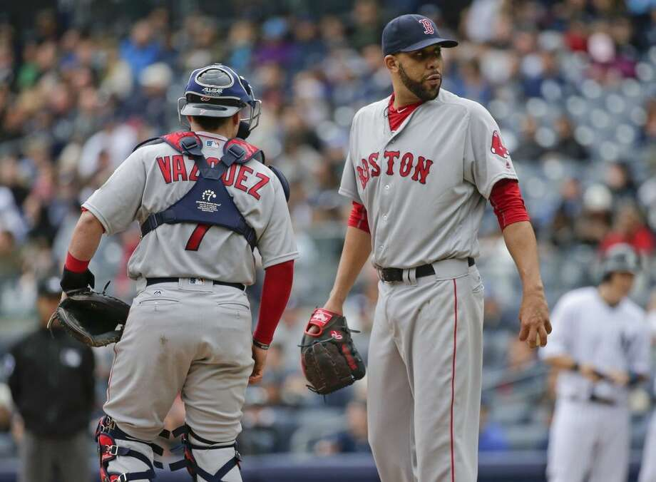 Boston Red Sox starting pitcher David Price, right, and catcher Christian Vazquez (7) talk while the bases are loaded during the fourth inning of a baseball game against the New York Yankees Saturday, May 7, 2016, in New York. (AP Photo/Frank Franklin II)