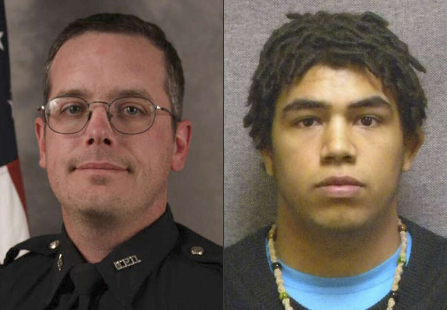This combination made with file photos provided by the Madison, Wis. police department and Wisconsin Department of Corrections shows Madison Police officer Matt Kenny, left, and Tony Robinson, a biracial man who was killed by the officer. Kenny shot the unarmed 19-year-old in an apartment house on March 6. (Madison Police Department/Wisconsin Department of Corrections via AP)