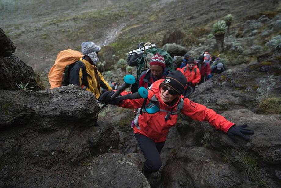 A group of multiple myeloma patients, doctors, nurses and researchers climbed Mt. Kilimanjaro as part of the Moving Mountains for Multiple Myeloma fundraiser for the Multiple Myeloma Research Foundation.