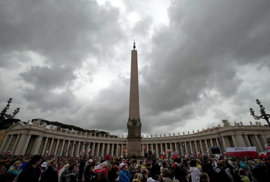 People fill St. Peter's Square at the Vatican, Sunday, April 27, 2014. Pope Francis has declared his two predecessors John XXIII and John Paul II saints in an unprecedented canonization ceremony made even more historic by the presence of retired Pope Benedict XVI. (AP Photo/Vadim Ghirda)