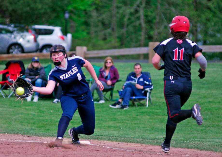 Staples' Cat Connell, left, attempts to catch the throw to first base during a game against New Canaan Tuesday.
