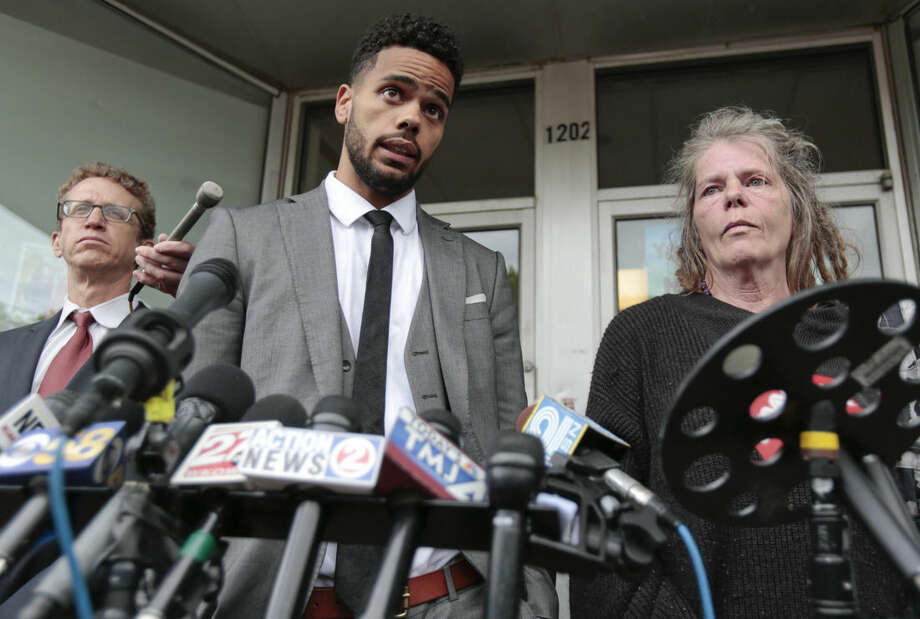 Turin Carter, center, uncle of Tony Robinson, speaks next to family attorney Jon Loevy, left, and Robinson's grandmother Sharon Irwin during a news conference at the Social Justice Center, Tuesday, May 12, 2015, in Madison, Wis., Tuesday. Dane County District Attorney Ismael Ozanne announced Tuesday that Madison Police Officer Matt Kenny would not face charges for the shooting death of Robinson. (M.P. King/Wisconsin State Journal via AP)