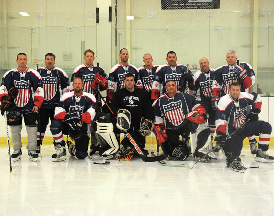 The Norwalk police hockey team Sunday at the Human Services Council's Pucks For Prevention Charity Hockey Game to benefit the Children's Connection. Hour photo/Matthew Vinci