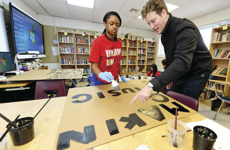 London-based artist Peter Liversidge, artist-in-residence at Ridgefield's Aldrich Contemporary Art Museum, teaches students at Norwalk's Side by Side Charter School in Norwalk, Conn., including 13 year old Jahzara Bey, as part of the museum's Common Ground program on Thursday May 5, 2016. The students work will be exhibited alongside Liversidge's installation at the Adrich starting in July.