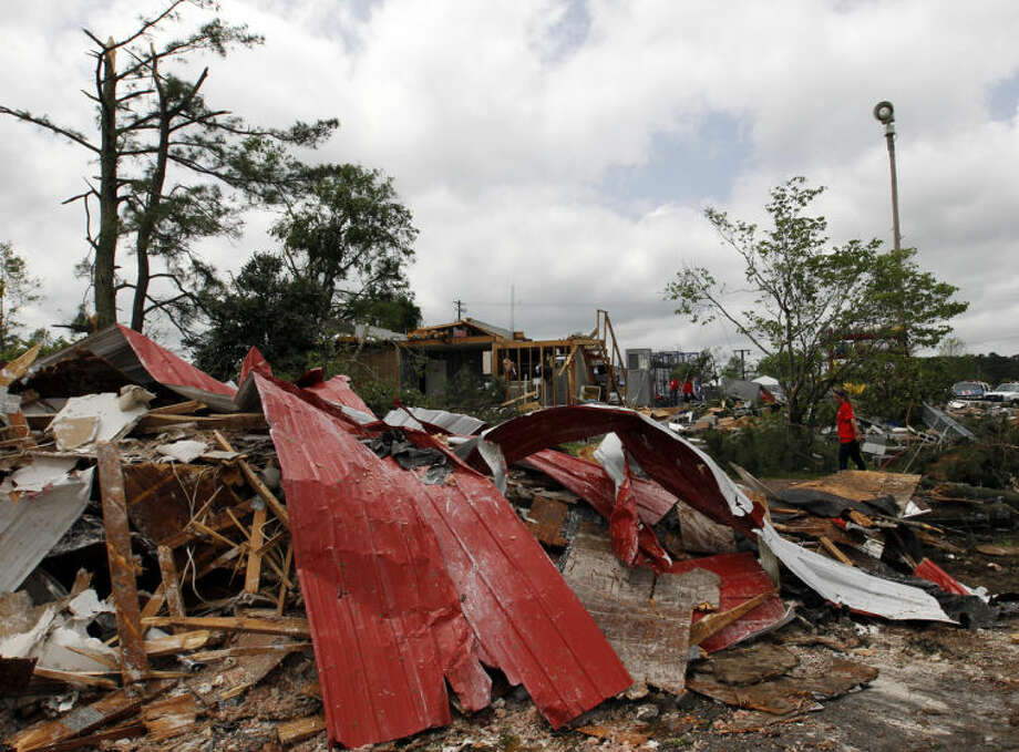 Volunteers help clean up after a tornado passed through destroying the Kimberly Fire Department on Tuesday, April 29, 2014, in Kimberly, Ala. (AP Photo/Butch Dill)