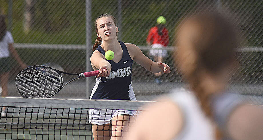 Brien McMahon's Julita Przybylska hits a volley return at the net during her first doubles match against Norwalk on Wednesday in FCIAC girls tennis action. The Senators defeated their cross-city rivals 5-2.
