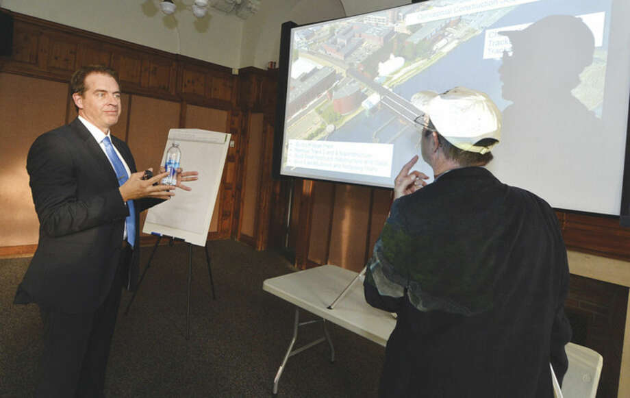 Chis Brown, Senior Project Manager, HNTB Walk Bridge Consultant shows a slide of an arial view during a public information meeting at Norwalk City Hall about the Walk Bridge replacement project, in Norwalk Conn. May 11 2016