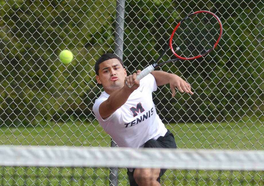 Brien McMahon's Luis Gonzalez plays Norwalk's Seiji Hosokawa in Boys singles tennis at Norwalk High School in Norwalk Conn. May 11, 2016
