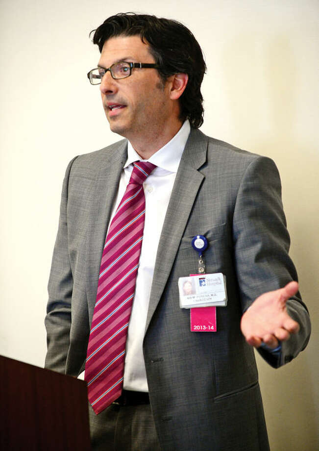 Hour photo / Erik Trautmann Norwalk Hospital's Dr. Ari Perkins speaks at The Human Services Council's Mid-Fairfield Substance Abuse Coalition community forum to discuss heroin and prescription drug abuse on Tuesday at HSC.