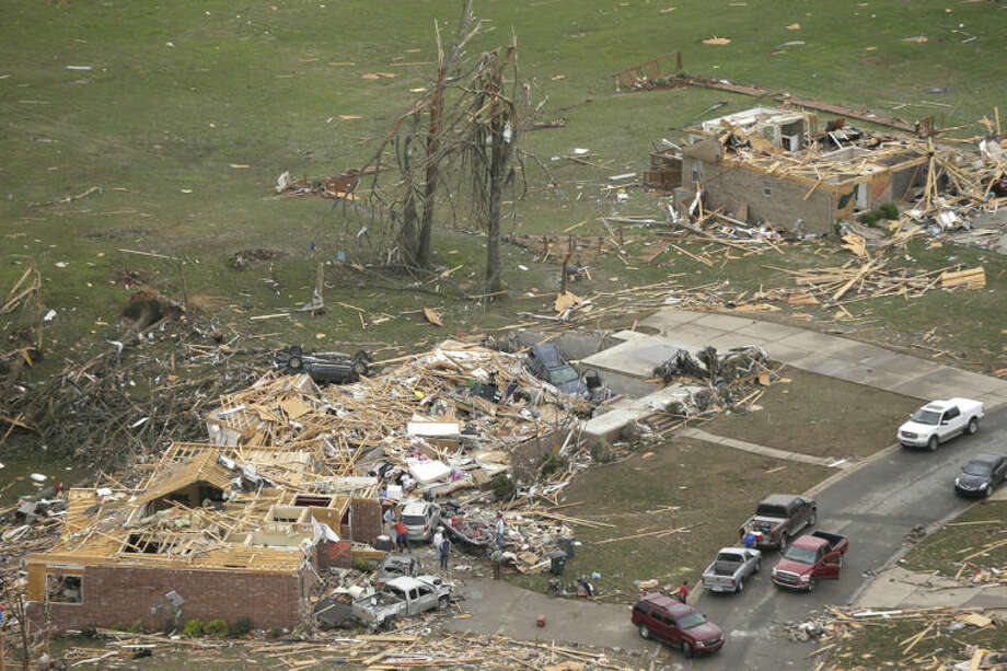 Houses are destroyed in Mayflower, Ark., Monday, April 28, 2014, after a tornado struck the town late Sunday. A tornado system ripped through several states in the central U.S. and left at least 17 dead in a violent start to this year's storm season, officials said. (AP Photo/Danny Johnston)