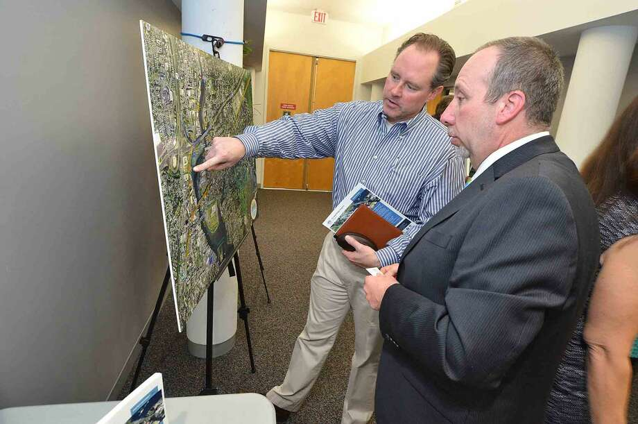 Colin Farmer on the Board of Directors at Maritime Condominiums looks at a map with John D. Hanfin, Transportation Supervising Engineer and Walk Bridge Program Manager during Connecicut Department of Transportation public information meetings at Norwalk City Hall about the Walk Bridge replacement project, in Norwalk Conn. May 11 2016