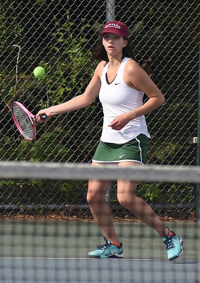 Norwalk's Emma Guilbault hits a forehand during her second singles match at Wednesday's FCIAC girls tennis match between cross-city rivals Brien McMahon and Norwalk. The Senators won, 5-2.