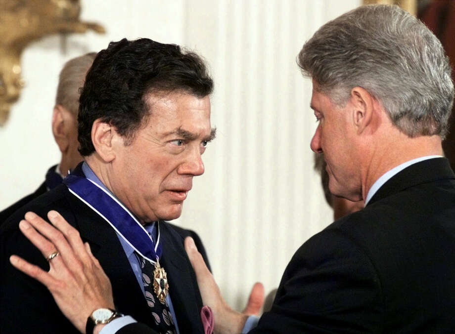 FILE - In this Aug. 11, 1999 file photo, President Clinton, right, awards the Presidential Medal of Freedom, the nation's highest civilian honor, to Edgar M. Bronfman at a ceremony held in the East Room of the White House in Washington. Bronfman, a Canadian born billionaire and longtime World Jewish Congress president died Saturday, Dec. 21, 2013, in New York, at the age of 84. (AP Photo/Pablo Martinez Monsivais, File) ORG XMIT: NY108