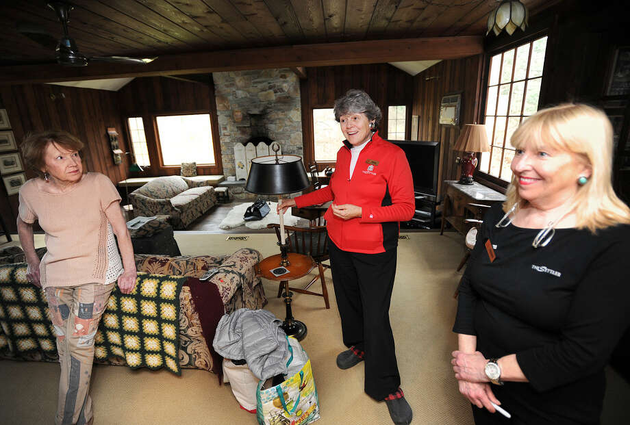 From left; client Karley Meltzer with The Settlers owner Pinny Randall and manager Terry VanDerheyden in her home in Westport, Conn. on Thursday, April 7, 2016. The Settlers is organizing Meltzer's move to California for retirement.