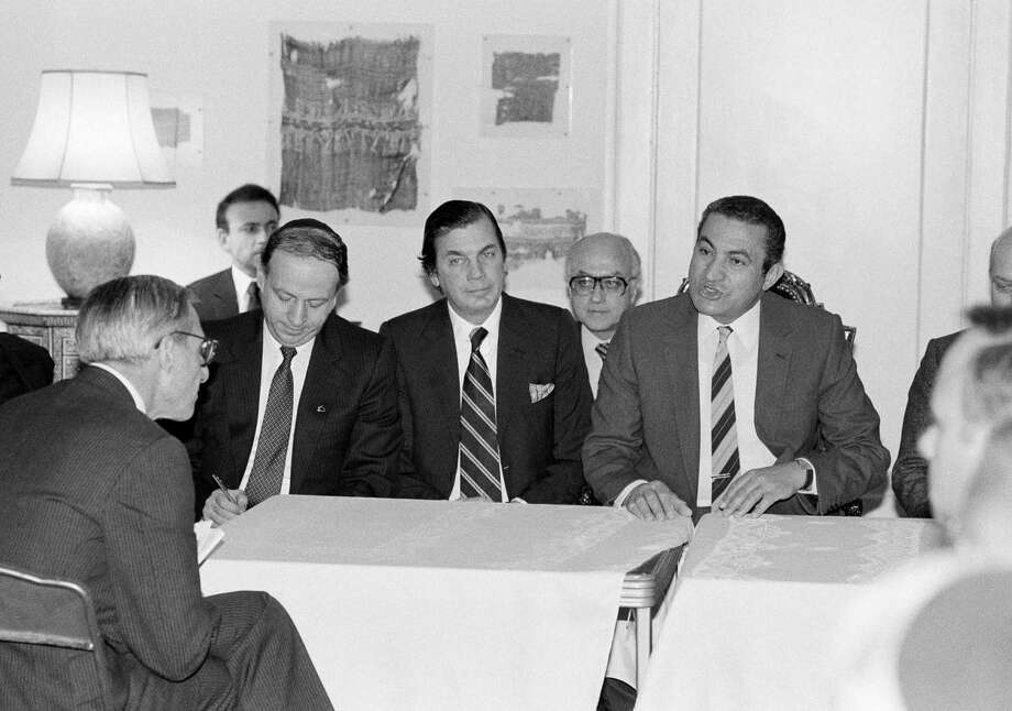 FILE - In this Jan. 28, 1983 file photo, Egyptian President Hosni Mubarak, right, and Edgar Bronfman, center, president of the World Jewish Congress, meet with American Jewish leaders in Washington. Bronfman, a Canadian born billionaire and longtime World Jewish Congress president died Saturday, Dec. 21, 2013, in New York, at the age of 84. (AP Photo/Barry Thumma, File) ORG XMIT: NY110