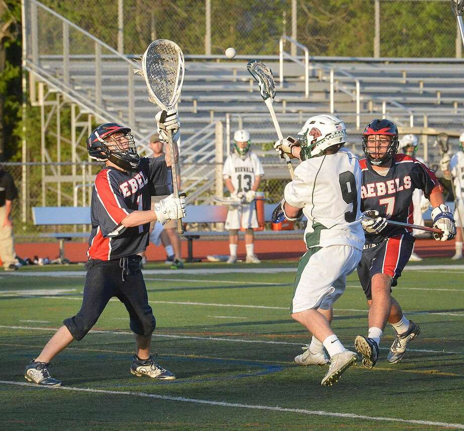 Hour Photo/Alex von Kleydorff Norwalks #9 Zachary Grimm shoots and scores vs New fairfield