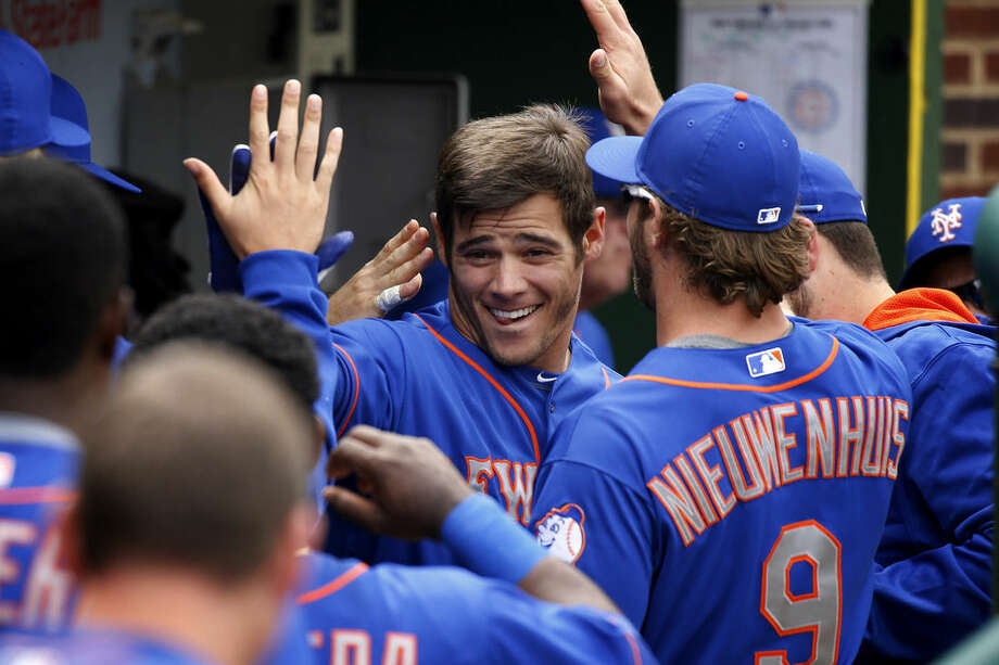 New York Mets' Anthony Recker, center, celebrates his solo home run against the Chicago Cubs during the fourth inning of a baseball game Thursday, May 14, 2015, in Chicago. (AP Photo/Andrew A. Nelles)