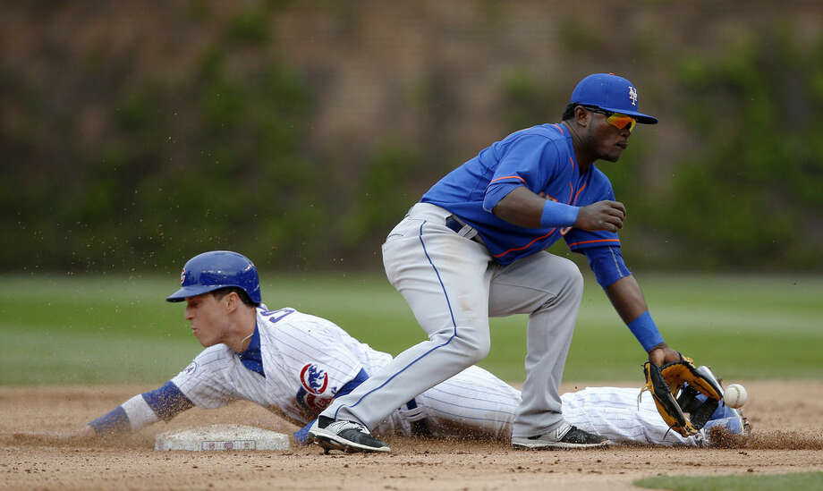 Chicago Cubs' Chris Coghlan (8) safely steals second base under New York Mets second baseman Dilson Herrera (2) during the eighth inning of a baseball game Thursday, May 14, 2015, in Chicago. The Chicago Cubs won 6-5. (AP Photo/Andrew A. Nelles)