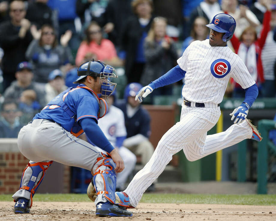 Chicago Cubs' Jorge Soler (68) scores past New York Mets catcher Anthony Recker (20) on an RBI-double hit by Matt Szczur during the fifth inning of a baseball game Thursday, May 14, 2015, in Chicago. (AP Photo/Andrew A. Nelles)