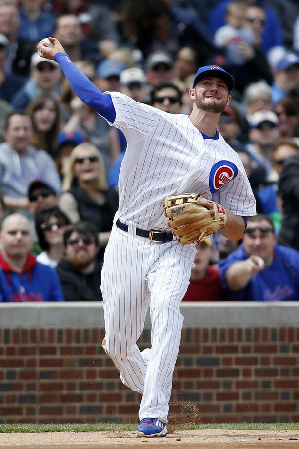 Chicago Cubs third baseman Kris Bryant (17) throws to first on a single hit by New York Mets' Dilson Herrera during the fifth inning of a baseball game Thursday, May 14, 2015, in Chicago. (AP Photo/Andrew A. Nelles)