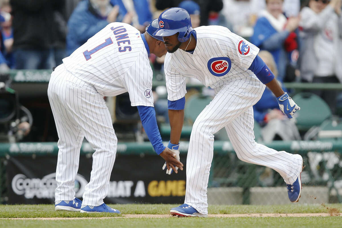Chicago Cubs' Dexter Fowler (24) celebrates his solo home run with third base coach Gary Jones (1) during the fourth inning of a baseball game against the New York Mets Thursday, May 14, 2015, in Chicago. (AP Photo/Andrew A. Nelles)