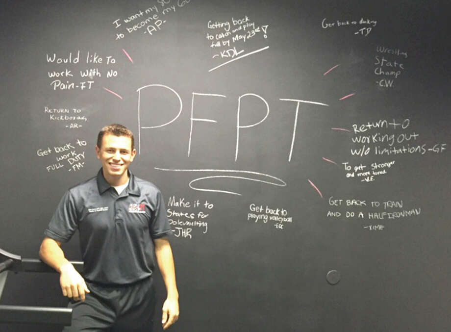 Former Norwalk High School second baseman Ben Kores, now a doctor of Physical Therapy in Florida, stands in front of the 'Goal Wall' at his new company People First PT. The 'Goal Wall' is used for patients to write their goals on. (Contributed Photo)