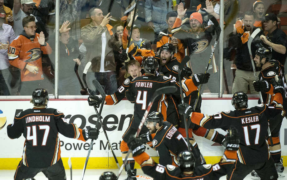corrects name of the photographerAnaheim Ducks' Corey Perry (10), rear left, celebrates his game-winning goal for a 3-2 overtime win against Calgary in Game 5 of a second-round series in the NHL hockey playoffs in Anaheim, Calif., Sunday, May 10, 2015. Anaheim eliminated Calgary and will face the Chicago Blackhawks in the Western Conference finals. (Kyusung Gong/The Orange County Register via AP) LA TIMES OUT MAGS