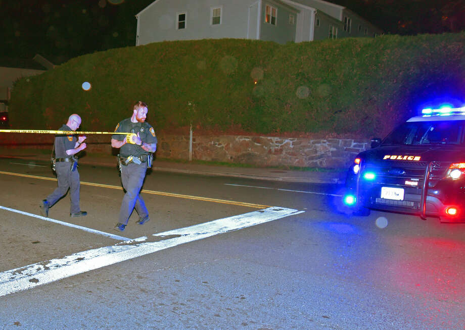Officers pull crime scene tape across Van Buren Ave. where two pedestrian were struck by a hit-and-run driver Wednesday, May 11, 2016. (Photo: Harold F. Cobin)