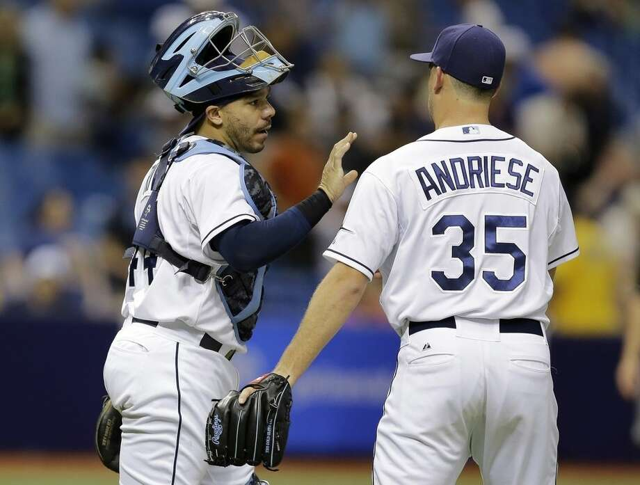 Tampa Bay Rays catcher Rene Rivera, left, congratulates relief pitcher Matt Andriese after closing out the New York Yankees during the ninth inning of a baseball game Thursday, May 14, 2015, in St. Petersburg, Fla. The Rays won 6-1. (AP Photo/Chris O'Meara)