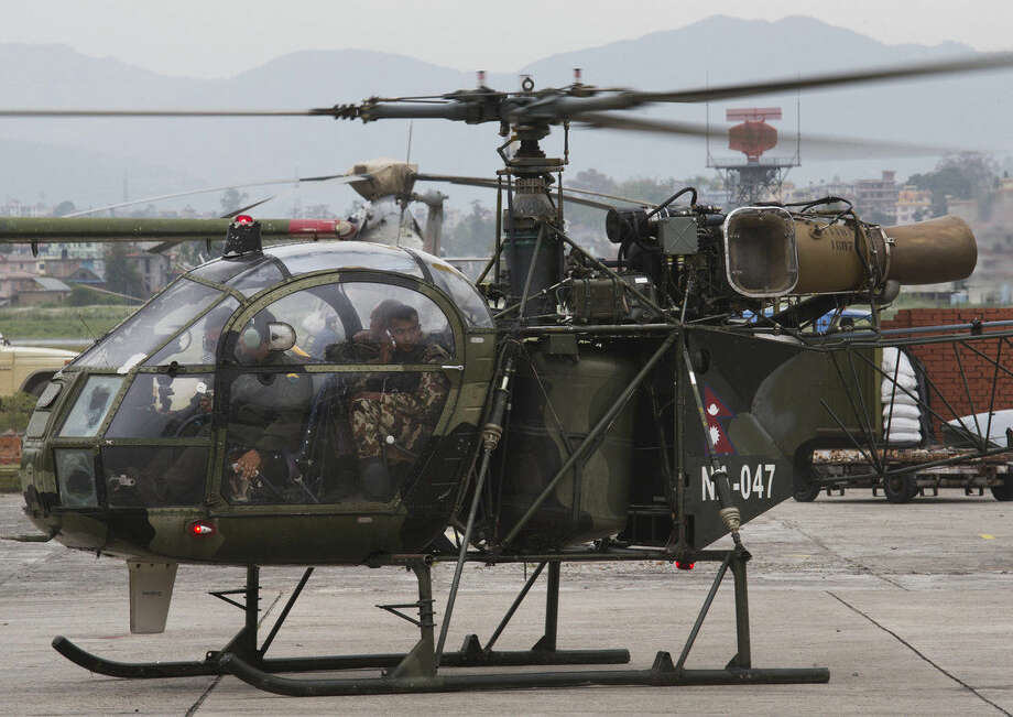 "A Nepalese army chopper, that spotted the suspected wreckage of a U.S. Marine helicopter, lands at the airport in Kathmandu, Nepal, Friday, May 15, 2015. Nepalese rescuers on Friday found three bodies near the wreckage of the chopper that was carrying six Marines and two Nepalese army soldiers. The U.S. Marines said they were sending their own rescue team to assess the wreckage and determine if it was the missing helicopter, the UH-1 ""Huey."" (AP Photo/Bernat Armangue)"