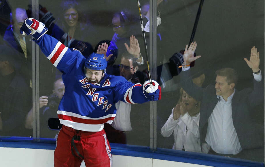 New York Rangers center Derek Stepan (21) reacts after scoring the winning goal against the Washington Capitals in overtime of Game 7 of the Eastern Conference semifinals during the NHL hockey Stanley Cup playoffs, Wednesday, May 13, 2015, in New York. The Rangers won 2-1. (AP Photo/Julie Jacobson)