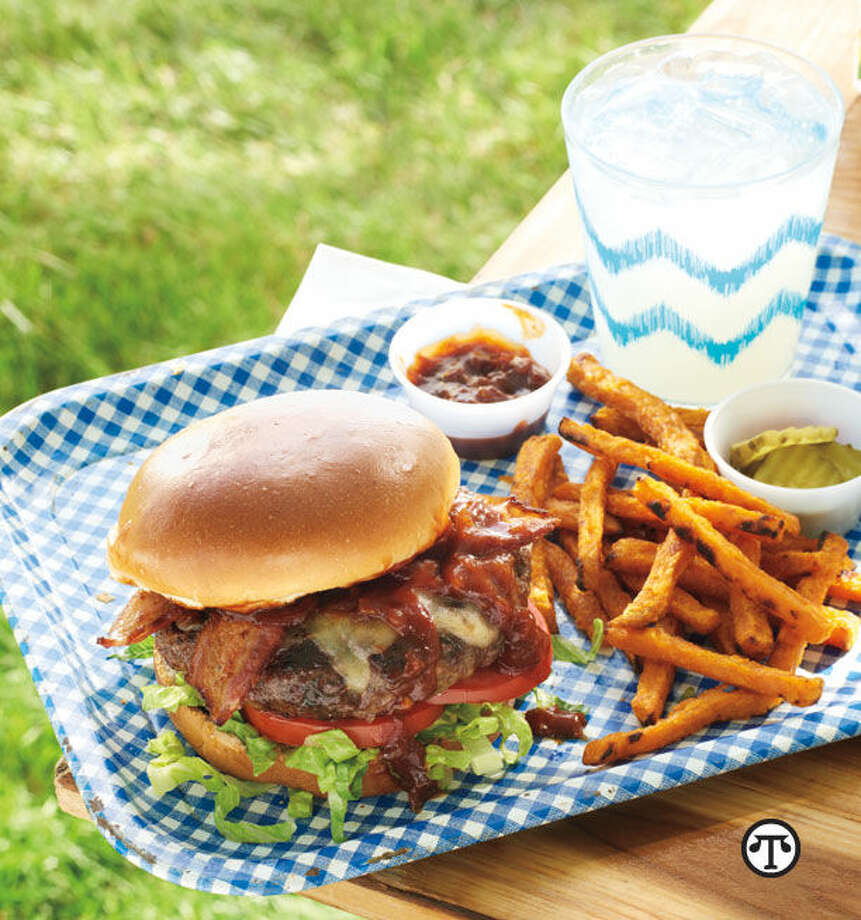 Bacon Cheeseburgers with Kentucky Bourbon Sauce can bring a delicious blend of BBQ styles to your next cookout. (NAPS)