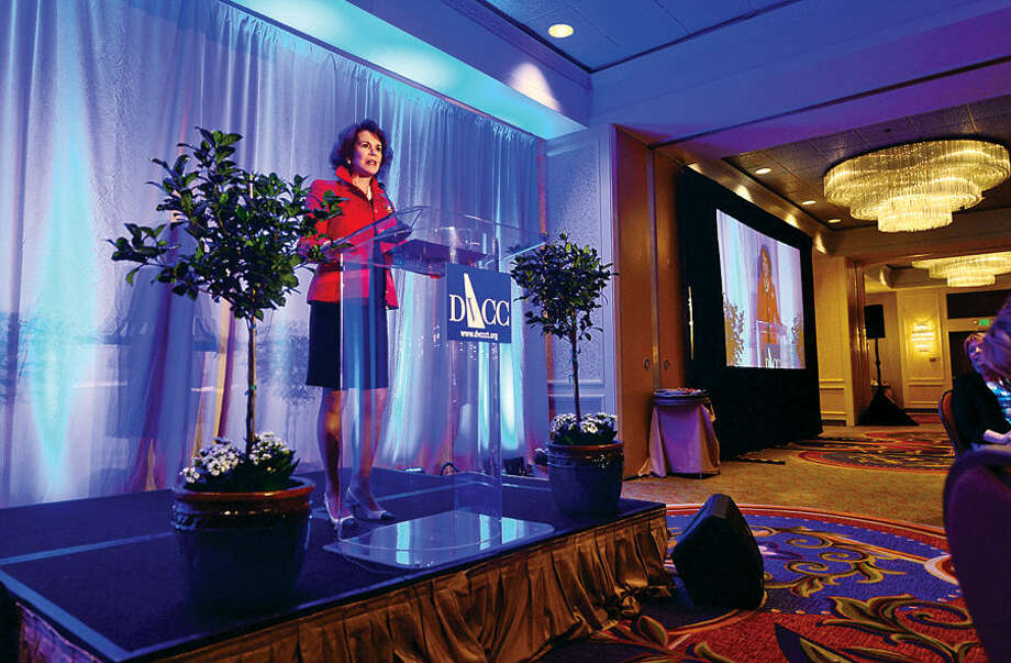 Voices of Courage honoree, Dede Bartlett, a business executive who has spent much of her career and personal life advocating for victims of domestic violence, makes her remarks during the Domestic Violence Crisis Center 13th annual Voices in Courage Spring Luncheon Thursday at the Stamford Marriott.