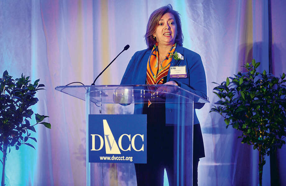 Domestic Violence Crisis Center Center Board Chair May Ellen Frank welcomes guests to the DVCC 13th annual Voices in Courage Spring Luncheon Thursday at the Stamford Marriott.