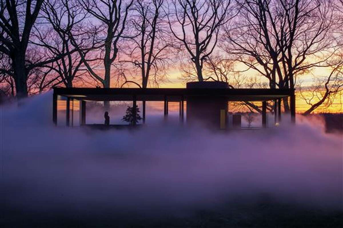 """This Saturday, April 19, 2014 photo provided by courtesy of The Glass House shows a fog installation, commissioned by the director of the Glass House, and designed to reflect and engage the aesthetic concepts central to the design of the iconic structure itself. Like the glass structure itself, """"Fujiko Nakaya: Veil"""" plays on the visible and invisible, transparent and opaque, permanent and ephemeral. The installation, about an hour's train ride north of New York City, is open to the public from May 1 to November 30, 2014."""